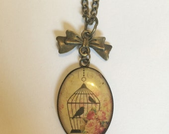 Birdcage & bow necklace
