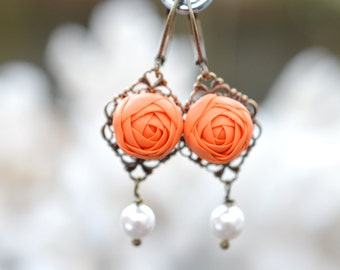 Richelle statement Earrings in Orange Ranunculus. Ranunculus earrings with pearls. Ranunculus jewelry