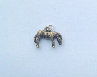 Tiny cute little vintage zebra charm