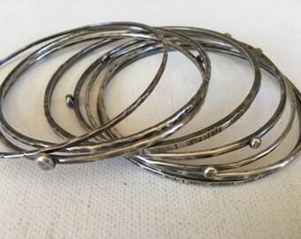 sterling silver bangles - hammered textured thick wire bracelets - set of seven bracelets - El Semanario