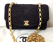 Vintage CHANEL charcoal black suede leather classic 2.55 shoulder purse with gold tone chain straps. Must have for fall and winter