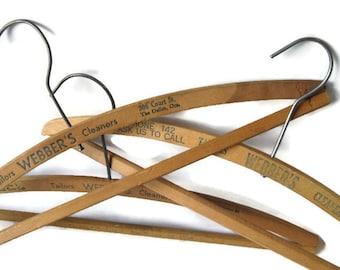 set of 3 vintage  hangers wooden advertising hangers The Dalles