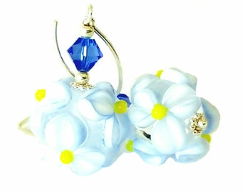 Beautiful textured blue flower lampwork bead earrings with yellow center. Bright sapphire blue Swarovski Crystals, Sterling Silver
