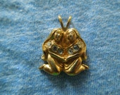 Vintage Avon Pin, 2 People (Nuns?),  Gold Toned with Rhinestones, Signed.  Nice.
