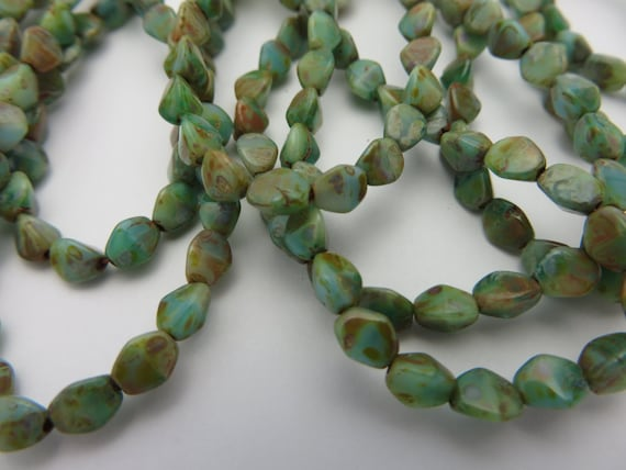 Bayside Turquoise Water And Sand Picasso 2x5mm Pinch Beads