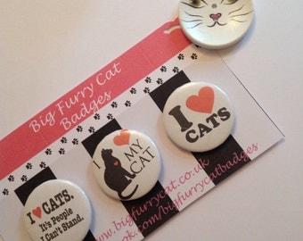 Trio of cat badges