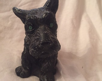 Scotty dog metal bank with green stone eyes