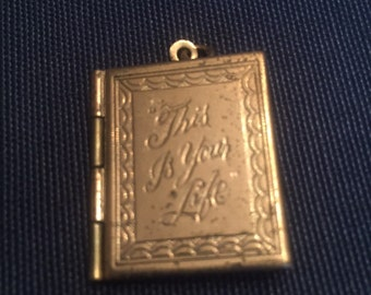 Antique This is your life pentant/charm