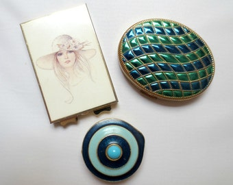 3 Vintage '70s Compacts: Avon Empress, Estee Lauder (Scarce), and one made in Japan, Two with Powder
