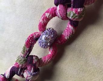 Japanese Chirimen cord knot bracelet + Swarovski Becharmed daisy