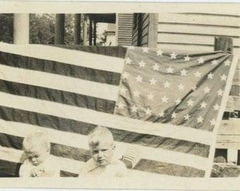 Two Children, American Flag, c1910s-20s Vintage Snapshot Photo [510422]