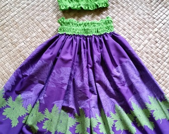 Royal purple and lime green for a splash of color in a bright hula pa'u for girls