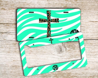 Zebra print front license plate or frame, Mint green with cheetah cross, Religious car tag (9980)