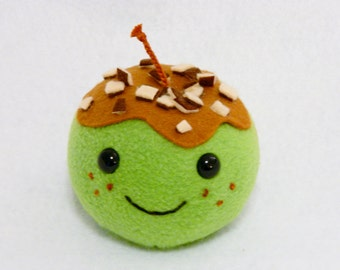 Plush caramel apple toy with nut topping