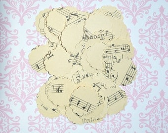 50 paper circles with musical note, 2,5 cm.