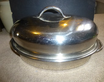 delightful dome covered oval roasting pan lidded form holds turkey ham chicken