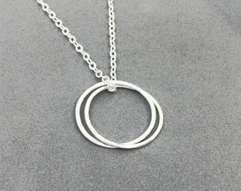 Sterling Silver, Karma Twin, Circle necklace, unisex, minimalist jewelry, symbol pendant, simple, dainty, layering, boho chic, yoga, charm