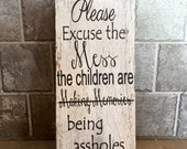 """Please excuse the mess, The children are making memories...being assholes, sarcastic wood sign, 12""""x5.5"""""""