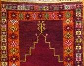 Antique hand knotted wool Turkish prayer rug natural vegetable dye maroon burgundy orange oriental mideastern Islamic tribal home decor