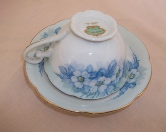 Occupied Japan Spoto Porcelain Cup & Saucer White Flowers Blue Leaves