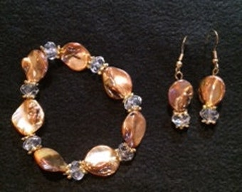 Glass and crystal that give the mother of pearl look with gold accents.