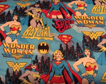 Girl Power Super Heros     Wonder Woman - Bat Girl -Super Girl    Camelot Cotton Blue Fabric   Sold by the Yard