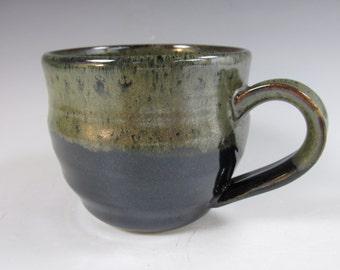 Large, handmade, stoneware coffee mug. Black and gold ceramic cup