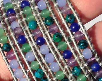 blues, purples, and greens wrap bracelet on metallic silver leather