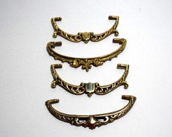 four vintage mismatched brass drawer handles