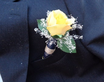 Spent navy blue shotgun shell designed with a yellow rose