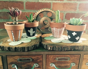 Assorted painted terracotta pots