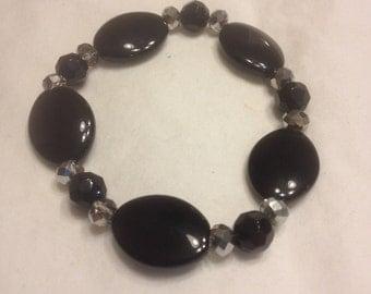 black and metallic grey beads