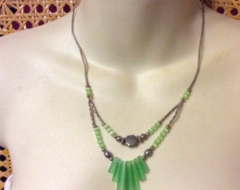 Vintage lime green cats eye glass beads tribal look necklace.