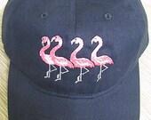 Four Flamingos on a Navy ...