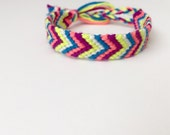 Pink, purple, yellow, white, and blue chevron friendship bracelet