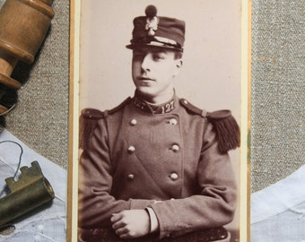 Antique French sepia photograph of a military man