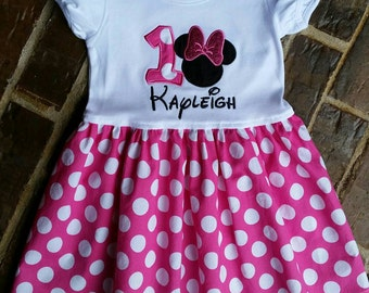 Girl's appliquéd Minnie Mouse pink polka dot dress with embroidered name and birthday number