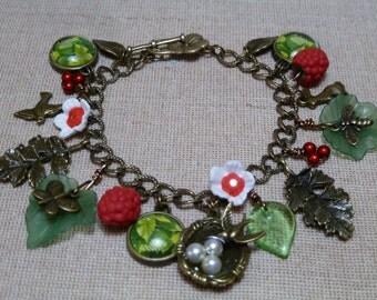 Wild berries bracelet, handmade, raspberries, flowers, charms antique gold, birds nest red boho