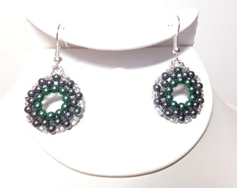 Round earrings with glass pearls and seed beads.