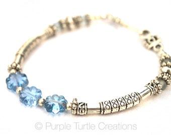 Silver bracelet with Czech glass flower beads     Light blue