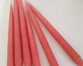 "Coral hand-dipped 10"" taper candles. One pair (2)."