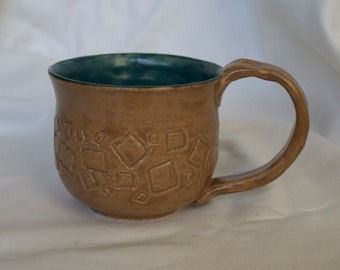 Mug in Oyster (Tan) With Square Patterned Accent. Teal Inside (Dark Blue/Green)