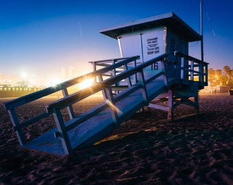 A lifeguard tower on the beach at night, in Santa Monica, California. | Photo Print, Stretched Canvas, or Metal Print.