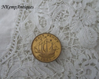 Old coin brooch