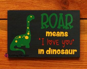 "ROAR means ""I love you"" in dinosaur sign"