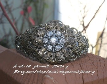 Cuff bracelet brass with rhinestones and layers of filigree. Vintage inspired cuff bracelet. Adjustable bracelet.