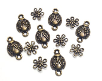 12 ladybug and flowers connectors bronze tone, 10 to 22mm  #CON 197