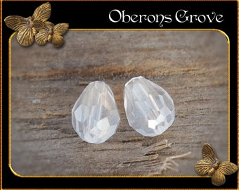 10 white coloured tear drop beads 4x6mm