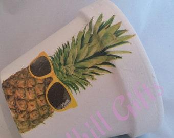 Hand decoupaged pineapple wearing sunglasses plant pot