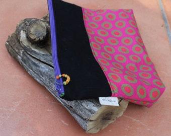 Cosmetic bag , Make-up bag , Purse organizer , Zipper pouch , Travel bag , Pencil case , Clutch bag , Handmade linen clutch , Rickilu bag .